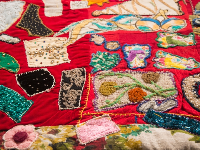 Pieced by Rosie Lee Tompkins, Unfinished (red velvet and embroidery), (detail). 75 in. wide x 57 in. high. Collection of Eli Leon. Photo: Terry Lorant
