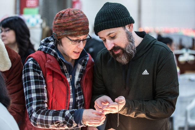 Shoppers admire jewelry at the White Elephant Sale
