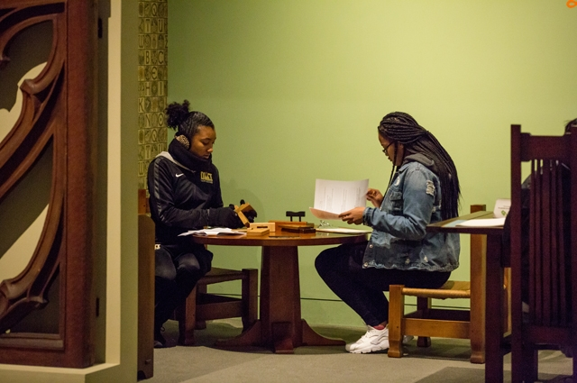 Two girls reading at a table