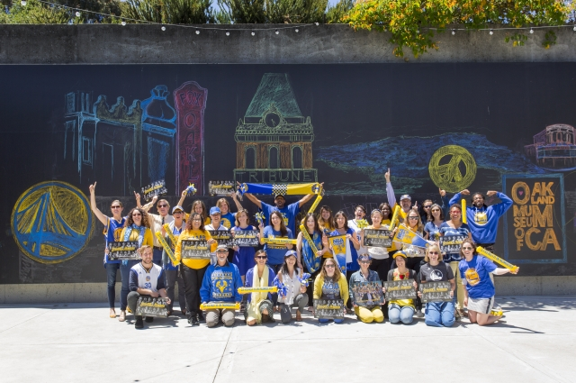 OMCA staff showing their Warriors pride. Photo: Oakland Museum of California