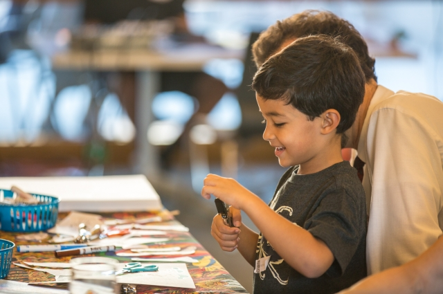 Little boy and father at art activity table