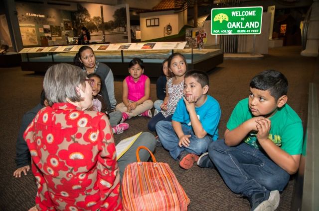 An OMCA Docent leads a tour for a diverse group of students. Photo: Odell Hussey Photography
