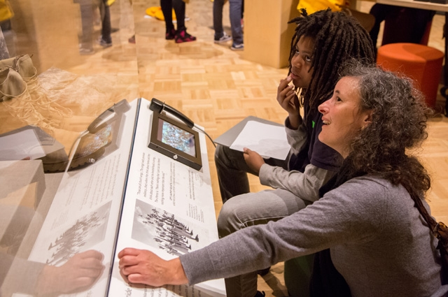 Young child and adult looking at a history diorama
