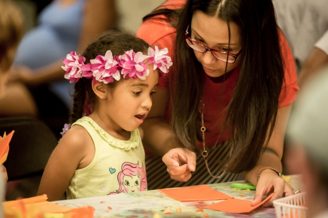 Family art activity table at Friday Nights at OMCA
