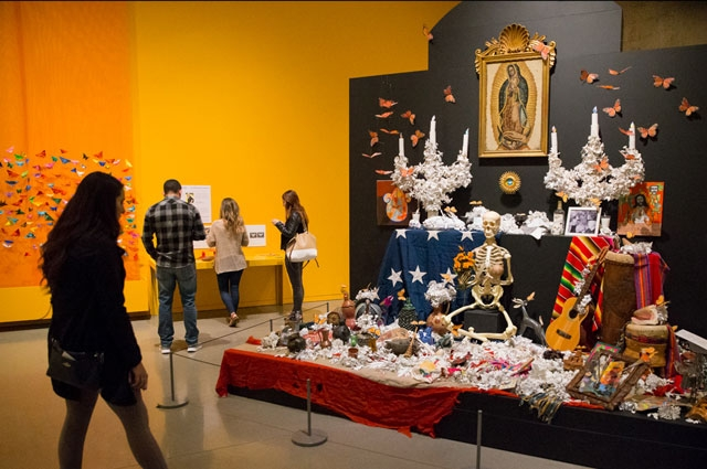 Days of the Dead altar by artist and poet Rafael Jesús González inside Metamorphosis & Migration: Days of the Dead at the Oakland Museum of California