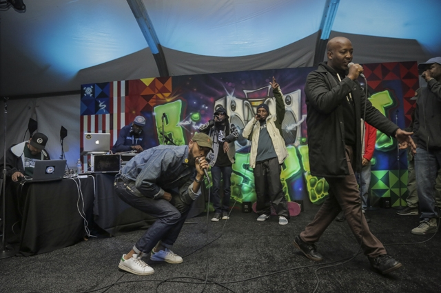 Two men on stage rapping
