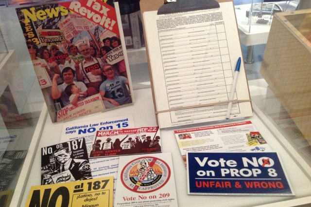 A selection of paraphernalia in the California to be Continued section of the Gallery of California History, from various campaigns for different ballot propositions. Included is a sticker from 2008's campaign to vote no on Proposition 8, which added a new provision to California's Constitution defining marriage as between a man and a woman.