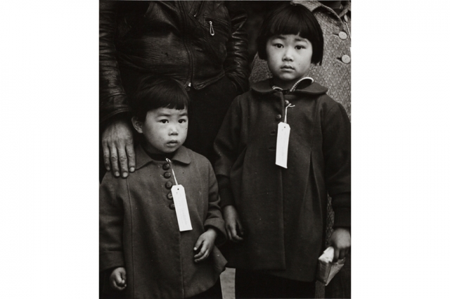 Dorothea Lange, Japanese Children with Tags, Hayward, CA, May 8, 1942.  Gelatin silver print, 11 x 14 in. Collection of the Oakland Museum of California,  gift of Paul S. Taylor
