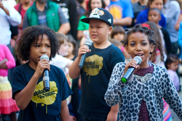 Three children holding microphones during Alphabet Rockers performance at Oakland Museum of California
