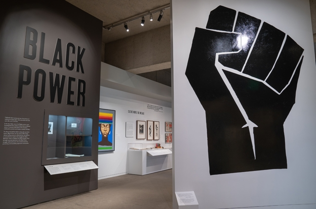 Black Power exhibit entrance in the Gallery of California History featuring a large black fist