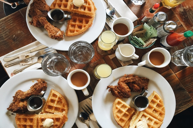 Waffles and hot sauce on a table