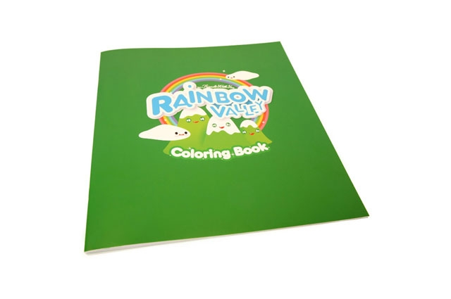 FriendsWithYou Rainbow Valley Coloring Book is green with cartoon characters at the OMCA Store Oakland Museum of California