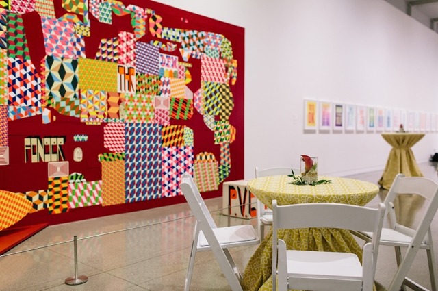 Artist Barry McGee red and white artwork called Pluralism in-gallery with table