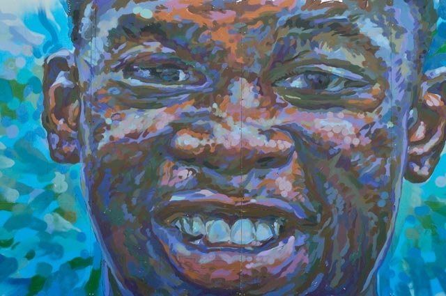 Brett Cook, Mark Bamuthi Joseph from the Reflections of Healing Series, 2014 (detail). Acrylic, Paint Pen, Spray Enamel on Plywood, 8 x 12 ft. Courtesy of the artist.