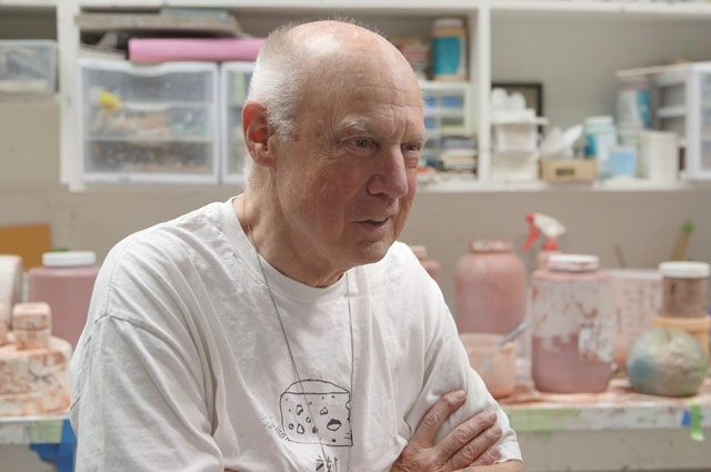 Ron Nagle sitting in his studio