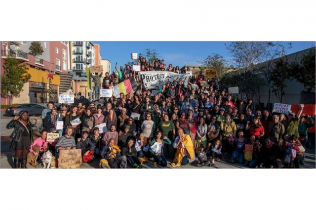 A photo from the annual protest at the Emeryville shellmound on the day after Thanksgiving from Corrina Gould's California Indian Living presentation. Image courtesy of Corrina Gould