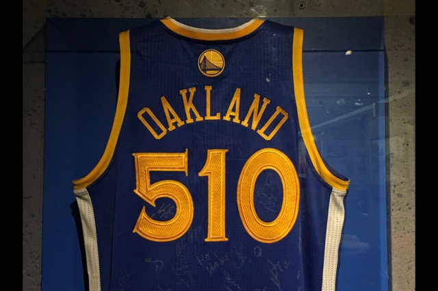 "A ""Warriors 510"" jersey hangs in the Gallery of California History"