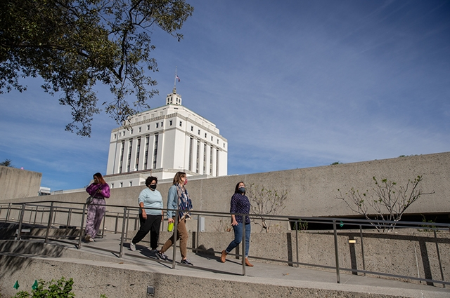 OMCA staff members walk down one of the outdoor ramps.