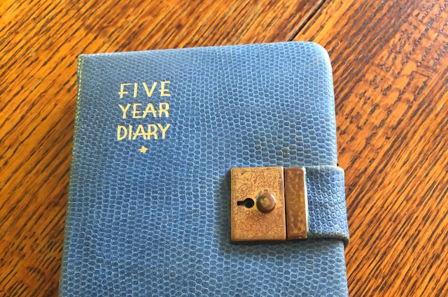 A blue diary that reads: Five Year Diary
