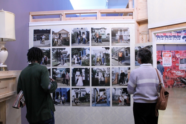 Inside the Victorian, a wall of photo portraits by Julie Plasencia depict the diversity and faces of the West Oakland community within just one block.