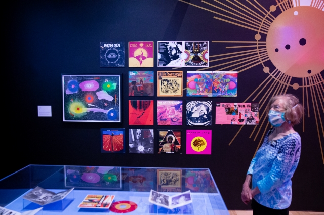 A woman takes in the Sun Ra section of the Mothership exhibit.