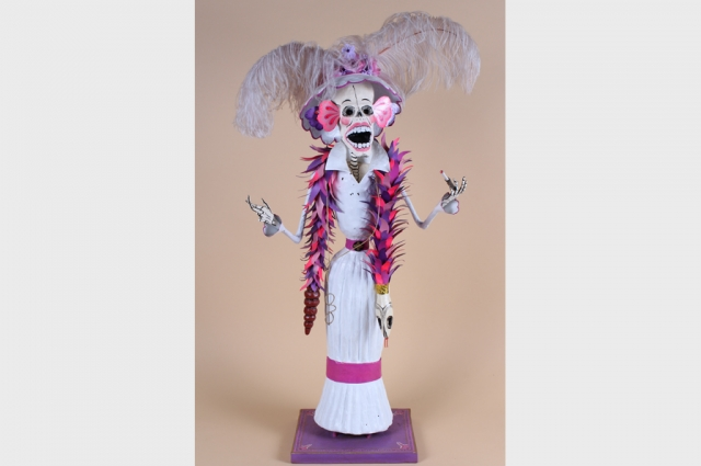 "Miguel Linares, Calaca Opera Goer, 1989. Polychrome papier-mache, feathers, metal, 34"" H x 17"" W x 9"" D. Courtesy of The Mexican Museum; Gift of the Estate of Paul Sherrill"