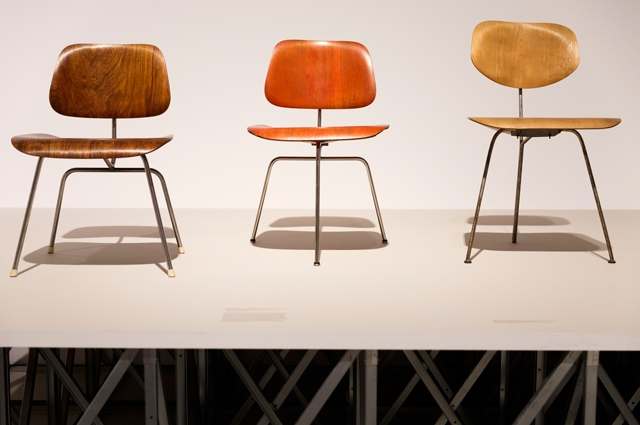 Three wooden chairs on view at The World of Charles and Ray Eames