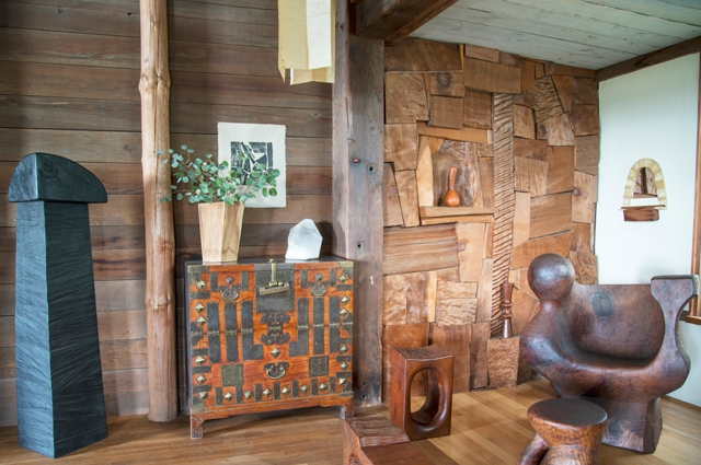 Inside artist J.B. Blunk's Inverness home with abstract wood sculptures, wood walls, and art.