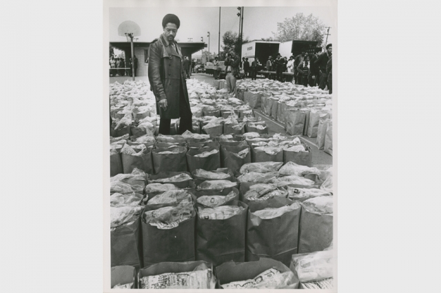 Howard Erker, Bobby Seale Checks Food Bags, 1972. Gelatin silver print, 10 x 8 in. The Oakland Tribune Collection, the Oakland Museum of California. Gift of ANG Newspapers.
