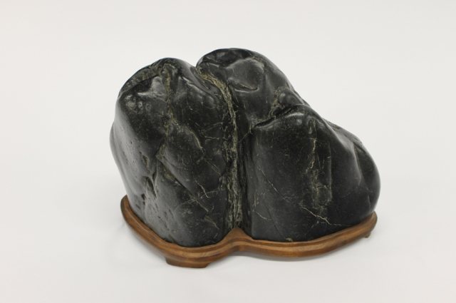9. John Nishizawa, Takiishi, collected stone and made daiza, 1990 Klamath River. Stone and wood, 7.5 x 10 x 5 inches. Collection of John Nishizawa