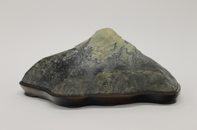 10. Mas Nakajima, Fuji-san, collected stone and made daiza finished,  c. 1995 collected c. 1990 Clear Creek. Serpentinite and wood, 5.5 x 13 x 7 inches. Collection of Janet Roth & Mas Nakajima