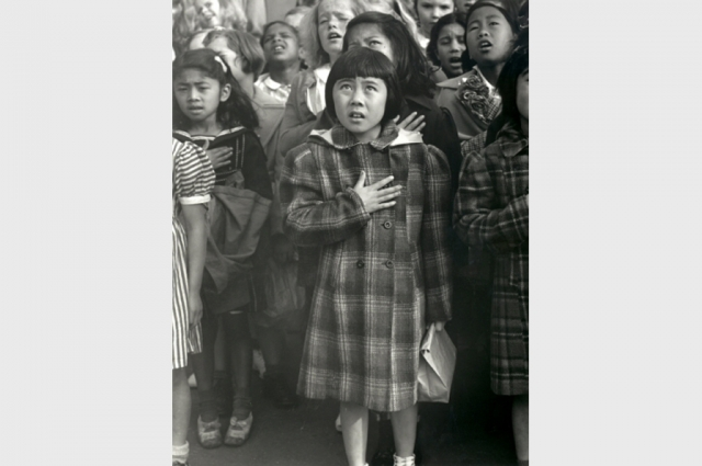 Japanese American school girls saluting the flag