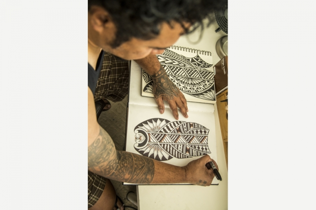 Fijian tattoo artist Lomani Gaunavinaka of Santa Rosa sketches tattoo designs. Photo: Jean Melesaine