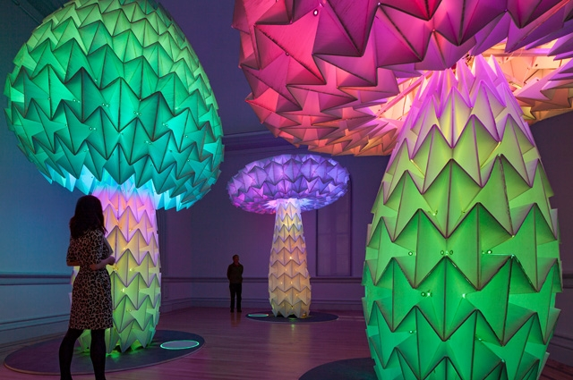 Three large, multicolored mushroom-shaped sculptures