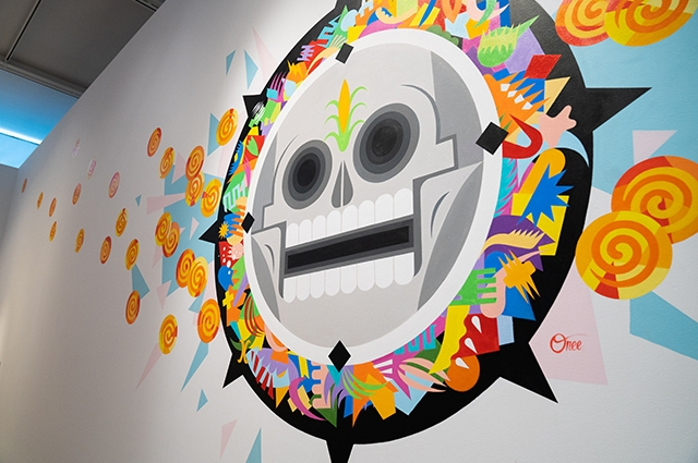 A large colorful skull painted on the wall in OMCA