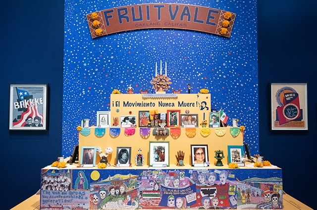 A large colorful ofrenda reading Fruitvale. Oakland, CA. El Movimiento Nunca Muere