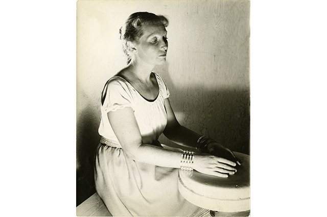 Black and white image of Edith Heath at a pottery wheel