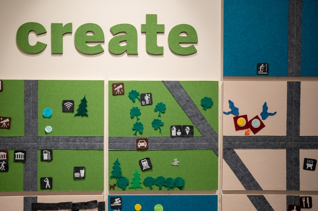 Large felt map with map icons and a large sign that reads: create