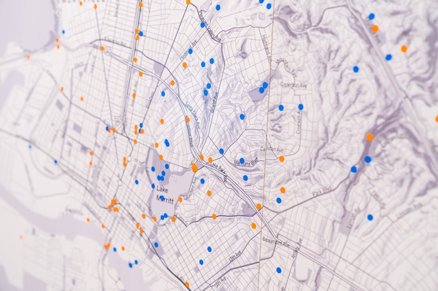 A large map of Oakland with blue and orange dots scattered about