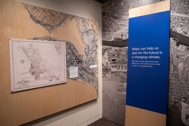 A large old map of Oakland with walls that have varying maps