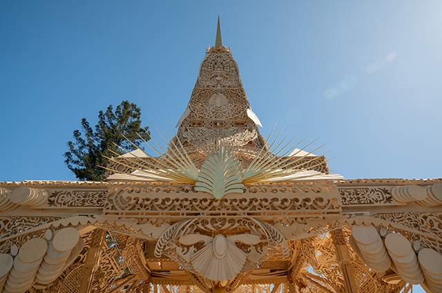A large, intricate, wooden temple outside