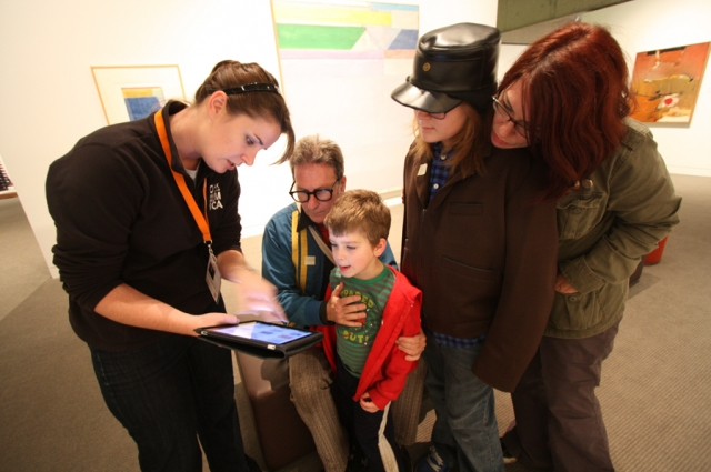 Gallery guides help visitors do research at OMCA in the galleries
