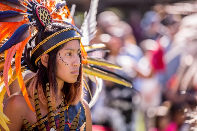 Child in feather headdress