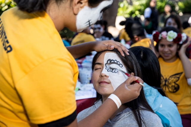 Child getting face painted