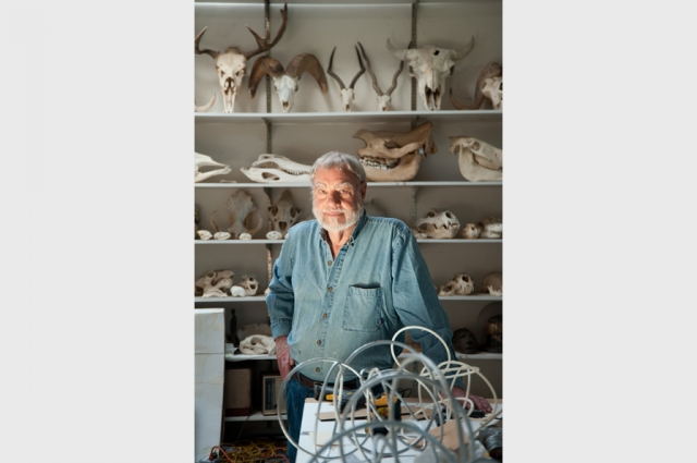 Sculptor Bruce Beasley amongst his collection of animal skulls, from which he draws inspiration for his organic, abstract works.  Photo: Terry Lorant. Courtesy of Oakland Museum of California.