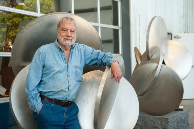 Sculptor Bruce Beasley outside of one of half a dozen buildings at his West Oakland studio complex, site of the future Bruce Beasley Sculpture Center. Photo: Terry Lorant. Courtesy of Oakland Museum of California.
