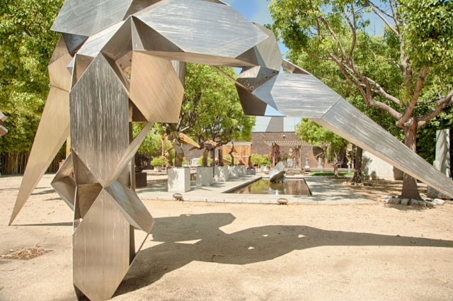 The lush sculpture garden at Bruce Beasley's studio complex, which takes much of two city blocks in West Oakland, and is the site of the future Bruce Beasley Sculpture Center. Photo: Terry Lorant. Courtesy of Oakland Museum of California.