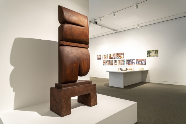 """Whistle"" wooden sculpture by J.B. Blunk on display in the gallery."