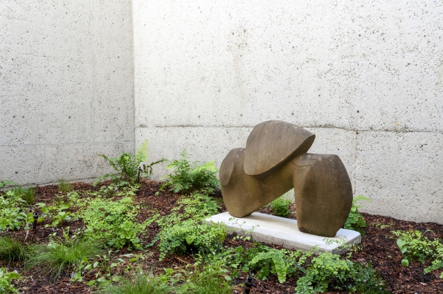 A stone sculpture outside in the alcove on Level 2 of the museum.