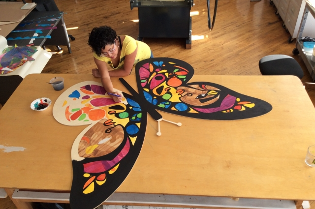 Artist Favianna Rodriguez working on art for the Oakland Museum of California Days of the Dead exhibition
